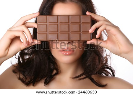 attractive woman covers her face with chocolate isolated on white - stock photo