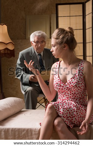 Attractive woman during psychological therapy of nymphomania - stock photo