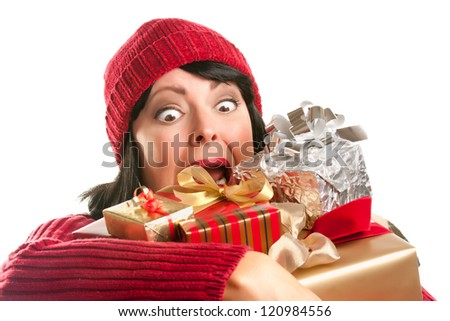 Attractive Woman Fumbling with Her Holiday Gifts Isolated on a White Background. - stock photo