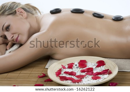 Attractive woman getting spa treatment isolated on white - stock photo