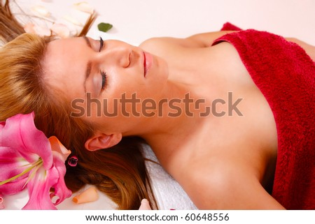 Attractive woman getting spa treatment over white