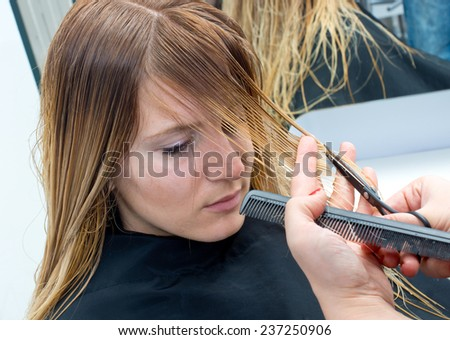 attractive woman having haircut in salon - stock photo