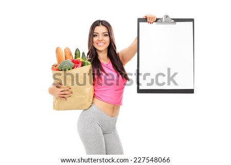 Attractive woman holding a grocery bag and a clipboard isolated on white background - stock photo