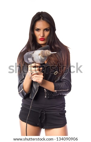 Attractive woman holding an electric drill - powertool on white background - stock photo