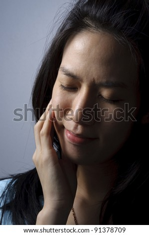 Attractive woman holding her hand on her aching tooth