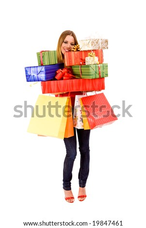 Attractive woman holding many gift boxes and bags. - stock photo