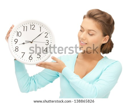 attractive woman holding wall clock in her hands - stock photo