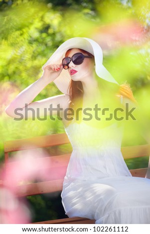 Attractive woman in a magic garden