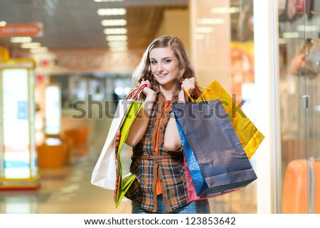 attractive woman in a store, shopping - stock photo