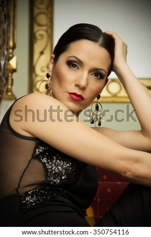 Attractive woman in black dress posing in a hotel Leopold I, which is set on Petrovaradin fortress at coast of Danube river near Novi Sad, Serbia. Property and model release attached.
