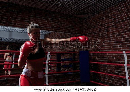 Attractive woman in boxing gloves