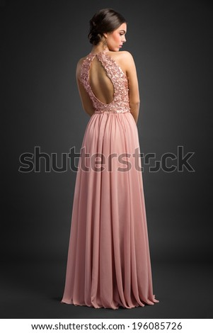 attractive woman in elegant long dress, back view - stock photo