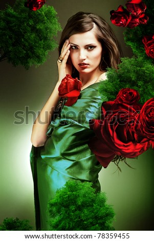 attractive woman in green fabric with red roses - stock photo
