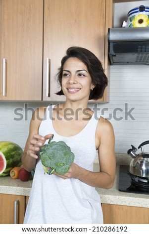 Attractive Woman In Kitchen, Enjoying Delicious Sweet Watermelon and Broccoli