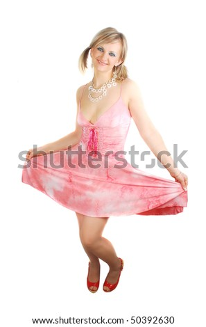 Attractive woman in pink summer dress dancing isolated on the white.