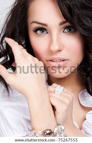 Attractive woman in white blouse posing in the studio - stock photo