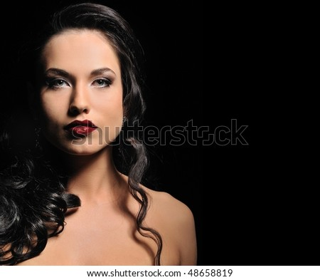 Attractive woman isolated on black background - stock photo