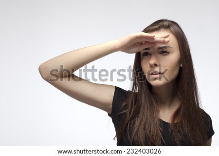 Attractive woman looking ahead with the hand in forehead on white background. Without make up. - stock photo