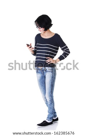Attractive woman looking on phone's screen. Isolated on white.  - stock photo