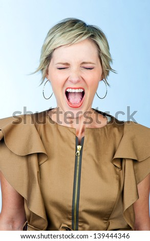 attractive woman making angry screaming expression