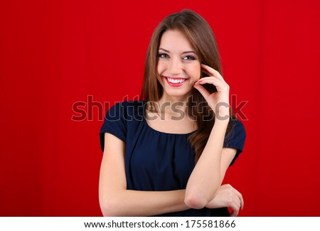 Attractive woman on color background - stock photo