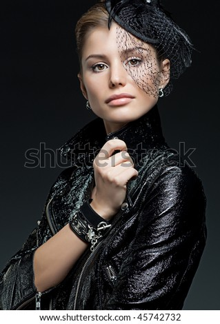 attractive  woman portrait on black background - stock photo
