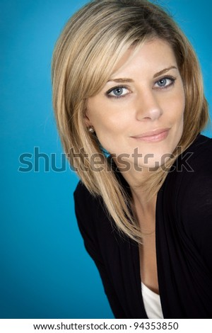 Attractive woman portrait on blue background - stock photo