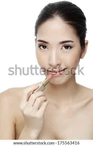 Attractive woman portrait on white background applying lipstick-Studio shot