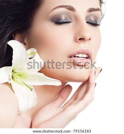 attractive woman portrait on white background with flower - stock photo