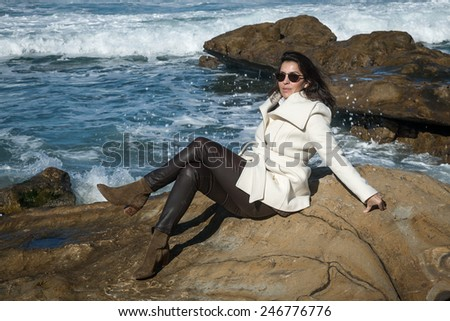 Attractive woman posing on the beach shore