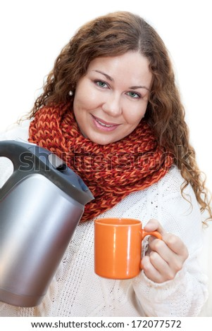 Attractive woman pouring hot water from the kettle into a mug, isolated on white background  - stock photo