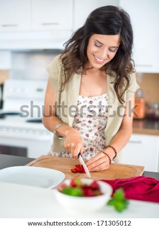 Attractive woman preparing fruits - stock photo