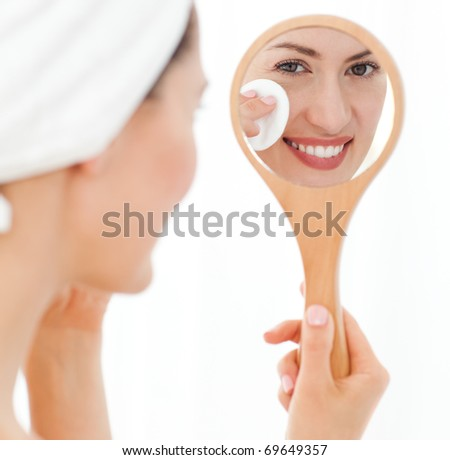 Attractive woman putting on Make up - stock photo