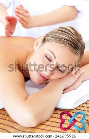 Attractive woman receiving a tapping massage against linking hearts