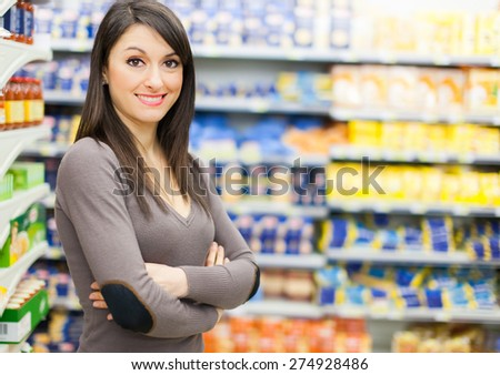 Attractive woman shopping in a supermarket - stock photo