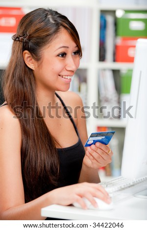 Attractive woman shopping online - stock photo