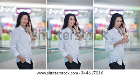 Attractive woman speaking on mobile in mall. Beautiful fashionable young girl in white male shirt posing in modern shopping center. Casual long hair brunette posing smiling talking on mobile indoor. - stock photo