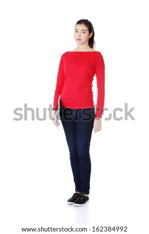 Attractive woman standing id red tshirt. Isolated on white.  - stock photo