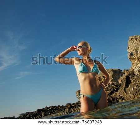 Attractive woman standing in the sea