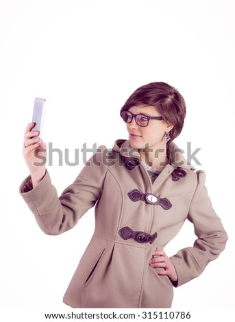 Attractive woman taking a selfie with her smartphone