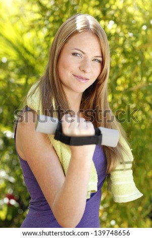Attractive woman trains outdoor