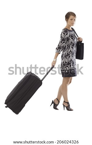 Attractive woman traveling with large baggage. Full size, isolated on white, dress, high heels. - stock photo