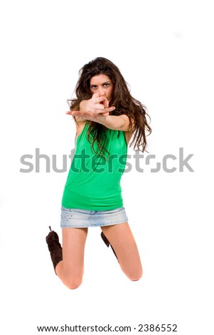 Attractive woman using her hands as if to fire at someone - stock photo