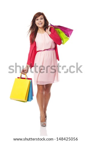 Attractive woman walking with shopping bags  - stock photo
