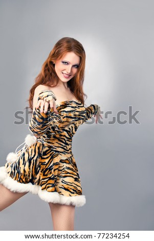 Attractive woman wearing tiger costume