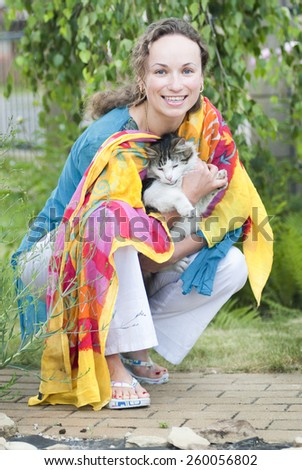 attractive woman with a cat - stock photo