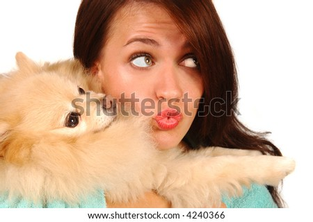 Attractive Woman with a very cute pomeranian puppy - stock photo