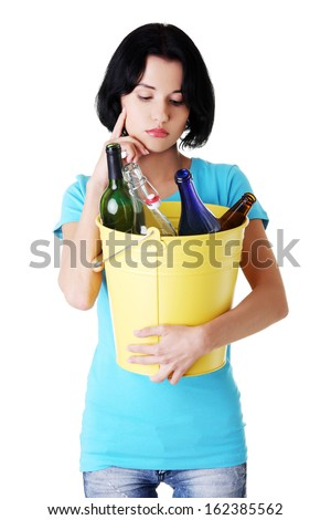 Attractive woman with bottles, recycling idea.  Isolated on white.  - stock photo