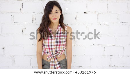 Attractive woman with checkered top and shorts