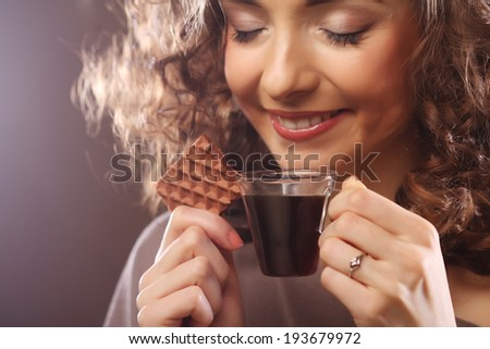 attractive woman with espresso coffee and cookies